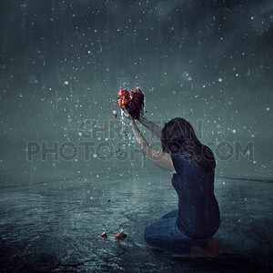 Broken heart during rain storm