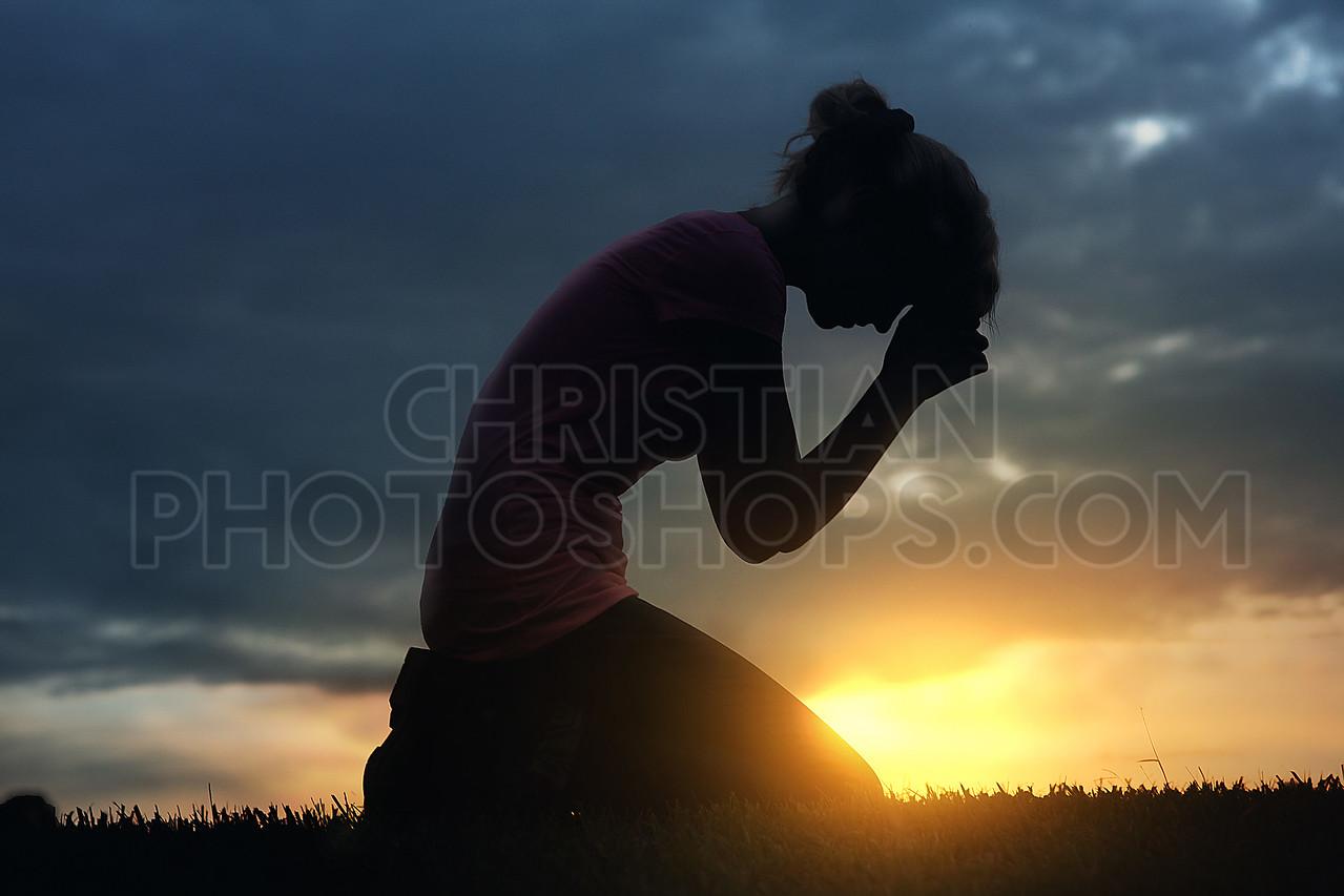 Praying at sunset
