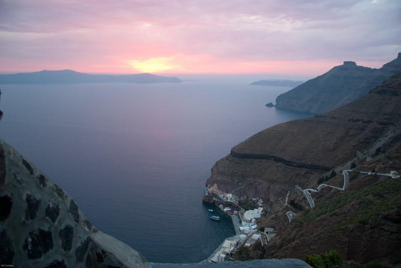 Santorini view of small harobor and sunsent