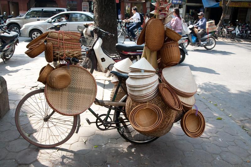 hat and basket vendor, Hanoi