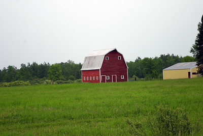 Red Barn on U.S. 169 just north of Aitkens, MN. On the Great River Road between Bemidji and Brainerd, MN, June 7, 2005 with rain and overcast skies.