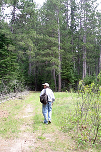 Walking back from Jerry's Private Campsite down a logging road to Pine Point Campsite on my visit to Jerry in Minnesota, June 2005.