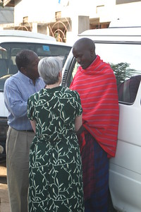 Samson Kisia & Ann Cretin witnessing to a Maasai man in Musoma, Nov. 10, 2005.