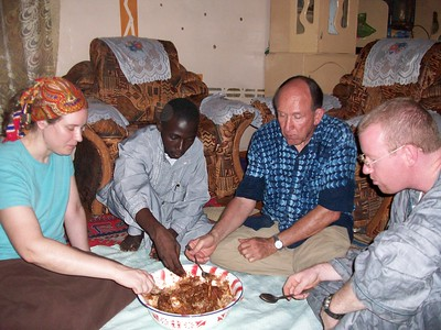 Charlie & Group Eating Typical Meal