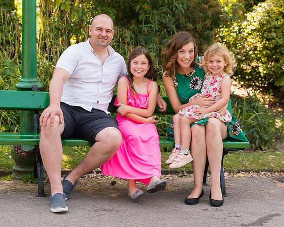 A fun shot of a family sitting in Longton Park, Stoke on Trent.