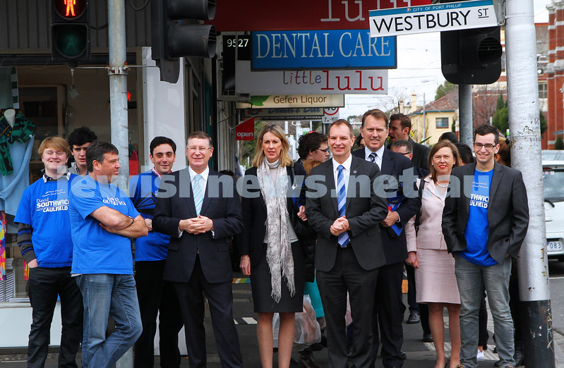 8-8-14. Victorian Premier Denis Napthine with his entourage, taking a walk along Carlisle Street.  Photo: Peter Haskin