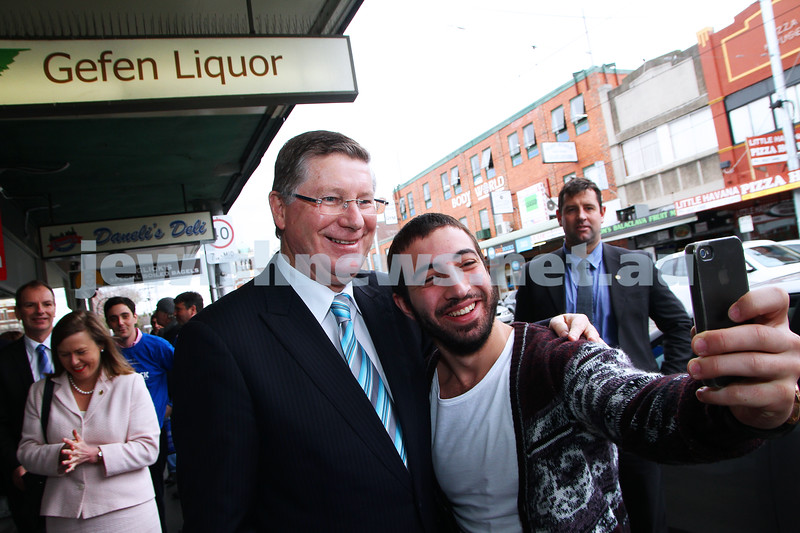 8-8-14. Victorian Premier Denis Napthine in Carlisle Street. The Premier having a selfie taken with one of the locals. Photo: Peter Haskin