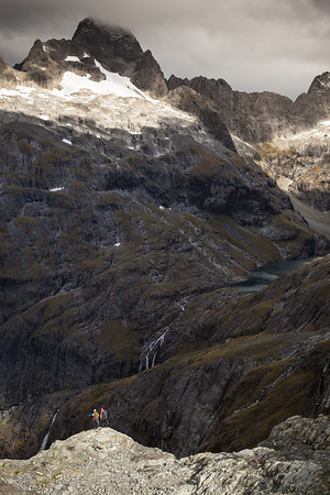 Two climbers approaching Lake Turner, Central Darran Mountains, Fiordland National Park