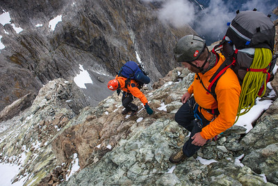 Climbers descending the south ridge of Tarewai towards Pikipari Pass, Fiordland National Park