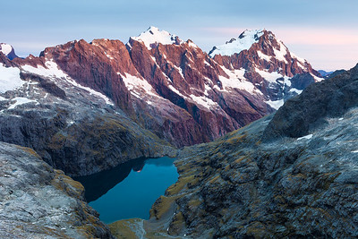 First light catches Mount Madeline and Mount Tutoko, Central Darran Mountains