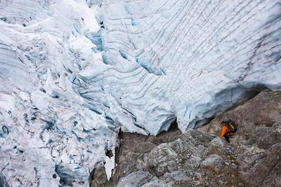 Climber descending into Donne Valley beneath Taoka Icefall, Darran Mountains, Fiordland