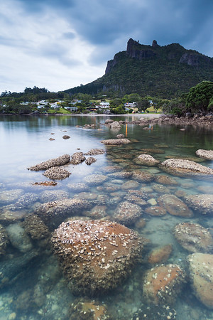 Manaia viewed across rocks, Taurikura Bay, Whangarei Harbour, Northland