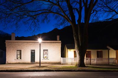 Heritage buildings beneath tree, Arrowtown, Otago