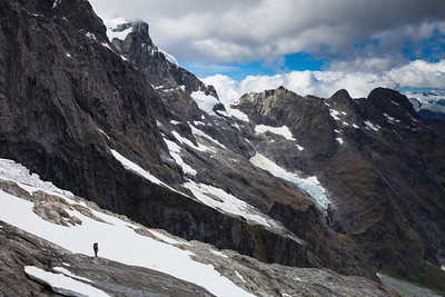 Climber descending beside the Cleft, below Mt Milne, Central Darran Mountains