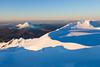 View from Mount Ruapehu, across summit plateau to Te Heu Heu and Tukino sub peaks and to Mount Ngauruhoe and Tongariro, Whakapapa skifield at left