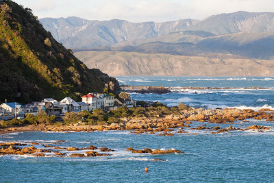 Houghton Bay homes with Pencarrow Head and Rimutuka Range in background, Wellington