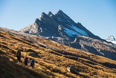 Three trampers below Pioneer Peak, Douglas Valley Route, Westland Tai Poutini National Park