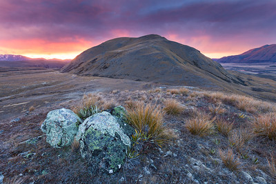 A stormy sunrise over the Hakatere Conservation Park and Mount Guy, Lake Clearwater, Inland Canterbury