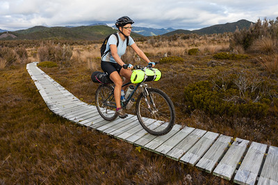 Female bikepacker, Big River - Waiuta Track, Victoria Forest Park