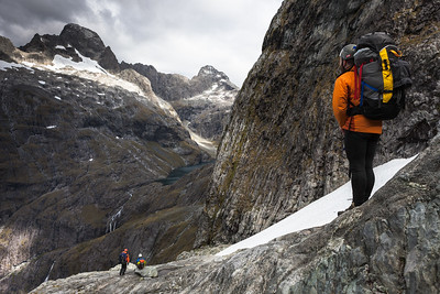 Three climbers approaching Lake Turner, Central Darran Mountains
