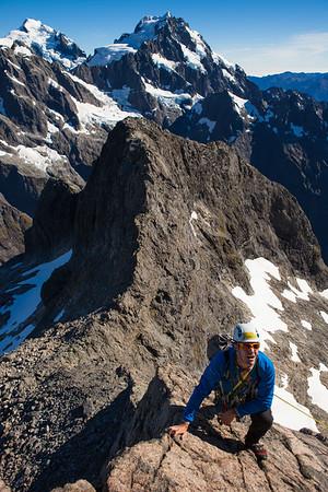 Mountaineer on the seldom climbed North Ridge of Te Wera. Central Darran Mountains, Fiordland