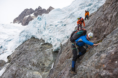 Three climbers descending into the Donne Valley, Darran Moutains, Fiordland