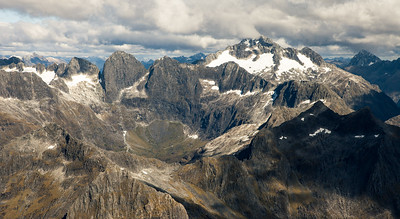 Moraine Creek and Hollyford Valley peaks: Adelaide, Sabre, Marian and Barrier Peak. Mts Crosscut and Christina in the background right, Fiordland National Park