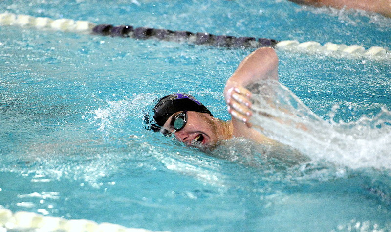 Water trails off the fingertips of Mountain View's Alex Gray as he competes in the 500-yard freestyle during Thursday's triangular with Valley and Estes Park at the Mountain View Aquatic Center. (Mike Brohard/Loveland Reporter-Herald)