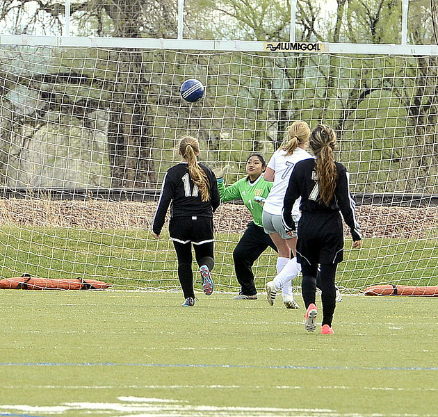 Resurrection Christian's Olivia Swan watches as her shot gets past the Valley goalie for a 2-0 lead in Thursday's match at Loveland Sports Park. (Mike Brohard/Loveland Reporter-Herald)