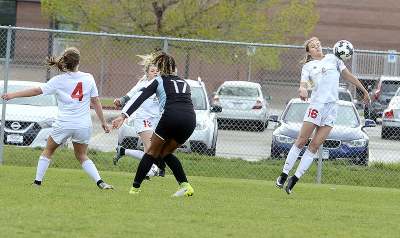 Loveland's Ava Hannaford uses her shoulder to gain control of the ball during Thursday's match with Greeley West at the Mountain View field. (Mike Brohard/Loveland Reporter-Herald)