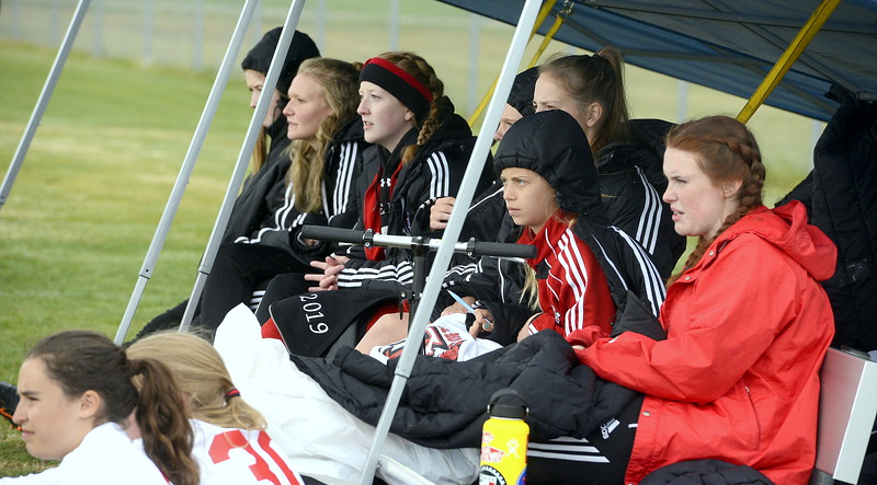 Loveland's bench watches the action from under a tent during Thursday's match with Greeley West at the Mountain View field. (Mike Brohard/Loveland Reporter-Herald)