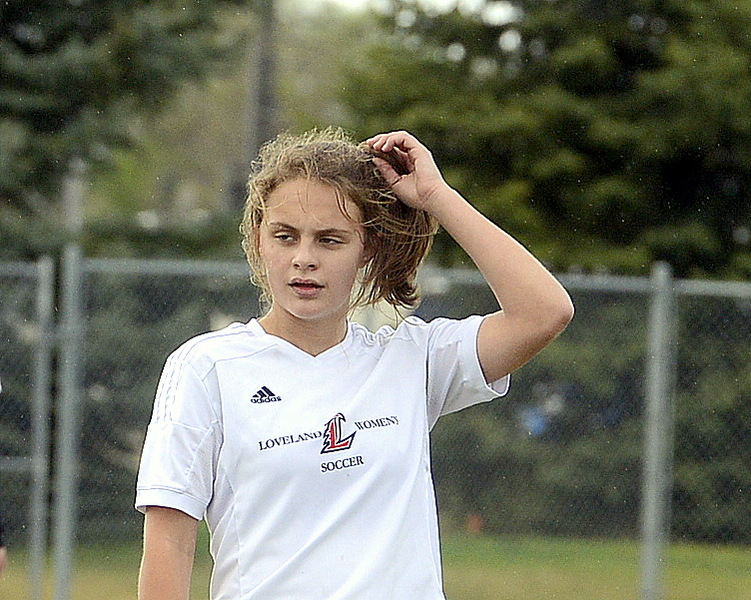 Loveland's Riley Hall plays with her ponytail in a break in the action Thursday as the Indians hosted Greeley West at the Mountain View field. (Mike Brohard/Loveland Reporter-Herald)