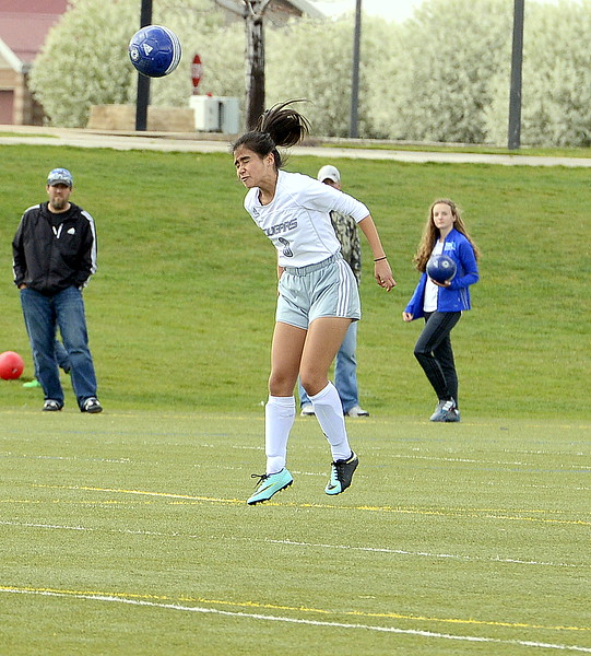 Resurrection Christian's Sadie Barger grimmaces as she delivers a header upfield during Thursday's match with Valley at Loveland Sports Park. (Mike Brohard/Loveland Reporter-Herald)