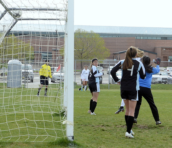 The header from Loveland's Ava Hannaford (hidden) finds the top shelf of the Greeley West goal at the end of the first half of Thursday's match with the Spartans at the Mountain View field. (Mike Brohard/Loveland Reporter-Herald)