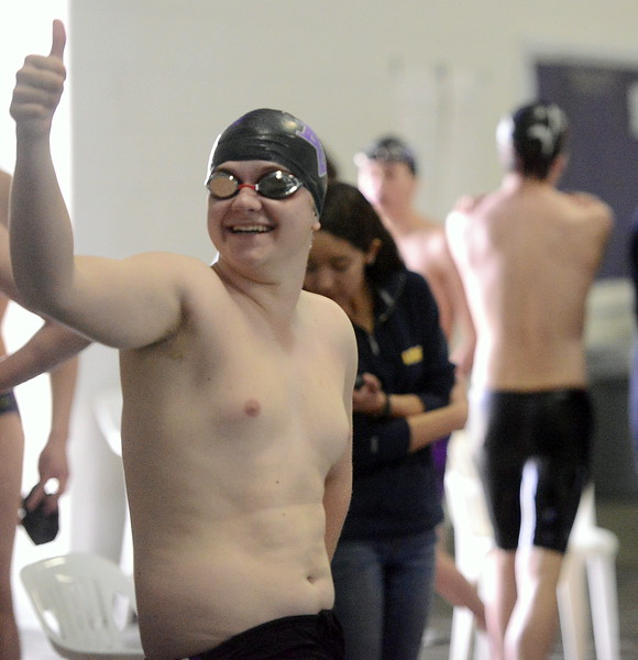Mountain View's Cameron Piccone gives his cheering section the thumbs-up prior to the 500-yard freestyle during Thursday's triangular with Valley and Estes Park at the Mountain View Aquatic Center. (Mike Brohard/Loveland Reporter-Herald)