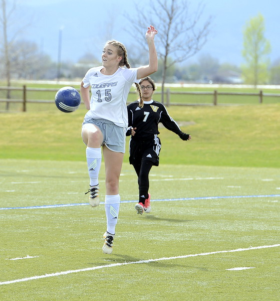 Resurrection Chritian's Gaviin Wolf uses her body to control the ball during Thursday's match with Valley at Loveland Sports Park. (Mike Brohard/Loveland Reporter-Herald)