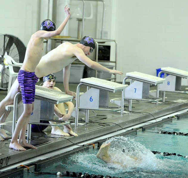 Mountain View's Avery Vinton (front) and Alex Gray cheer on teammate Julien Goering as he makes the turn during the 400-yard freestyle relay at Thursday's triangular with Valley and Estes Park at the Mountain View Aquatic Center. (Mike Brohard/Loveland Reporter-Herald)