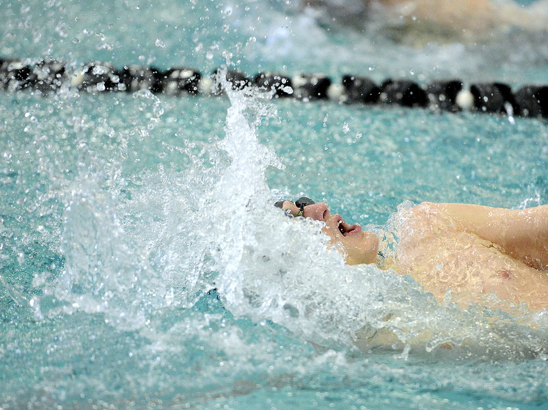 Noah Floyd of Mountain View heads for the finish of the 100-yard backtroke during Thursday's triangular with Valley and Estes Park at the Mountain View Aquatic Center. (Mike Brohard/Loveland Reporter-Herald)