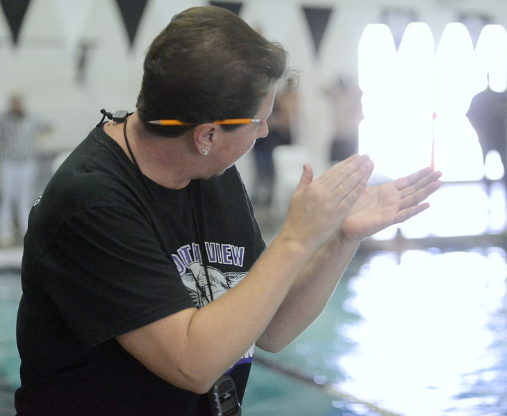 Mountain View coach Maria Strait cheers on her 500-yard freestyle crew during Thursday's triangular with Valley and Estes Park at the Mountain View Aquatic Center. (Mike Brohard/Loveland Reporter-Herald)