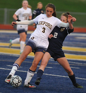 The Oxford Wildcats and Clarkston Wolves played to a 1-1 draw in the match played on Tuesday April 11, 2017 at Oxford High School.  (MIPrepZone photo by Ken Swart)