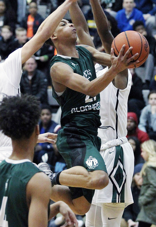 . Kevin McAdoo (21), West Bloomfield, goes up for two of his game high 34 points during Regional final basketball action against Novi at Walled Lake Northern High School Wednesday, March 15, 2017. McAdoo and the Lakers defeated Novi in double overtime 67-66. (MIPrepZone photo / LARRY McKEE)