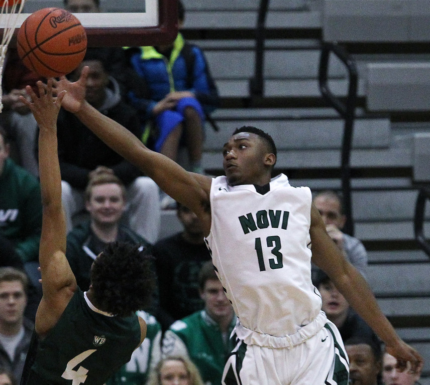 . West Bloomfield defeats Novi in a double overtime thriller 67-66 during Regional final basketball action at Walled Lake Northern High School Wednesday, March 15, 2017. (MIPrepZone photo / LARRY McKEE)
