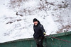 KELLY FLETCHER, REFORMER CORRESPONDENT -- Ian Clews stands ready to shovel snow on the in-run in preparation for the ski jumping competition at Harris Hill this weekend.