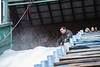 KELLY FLETCHER, REFORMER CORRESPONDENT -- Kyle Temple oversees the man-made snow coming out of the blower and onto the Harris Hill ski jump in preparation for the weekend's competition.