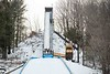 KELLY FLETCHER, REFORMER CORRESPONDENT -- Workers shovel man-made snow onto the in-run in preparation for this weekend's ski jumping competition at Harris Hill.