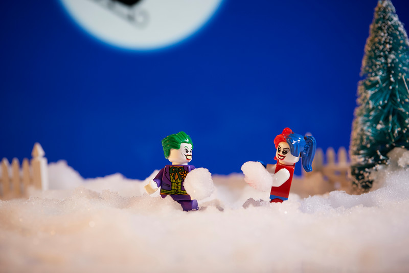 Joker and Harley Quinn snow ball  fight.