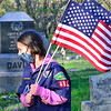 KRISTOPHER RADDER — BRATTLEBORO REFORMER<br /> Willa Cohen, 7, a Cub Scout, walks around the West Dover Village Cemetery, in Dover, Vt., on Thursday, May 21, 2020.