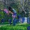 KRISTOPHER RADDER — BRATTLEBORO REFORMER<br /> Jack Mosher, a member of Boy Scouts Troop 461, puts an American flag on to veteran gravesites at West Dover Village Cemetery, in Dover, Vt., on Thursday, May 21, 2020.