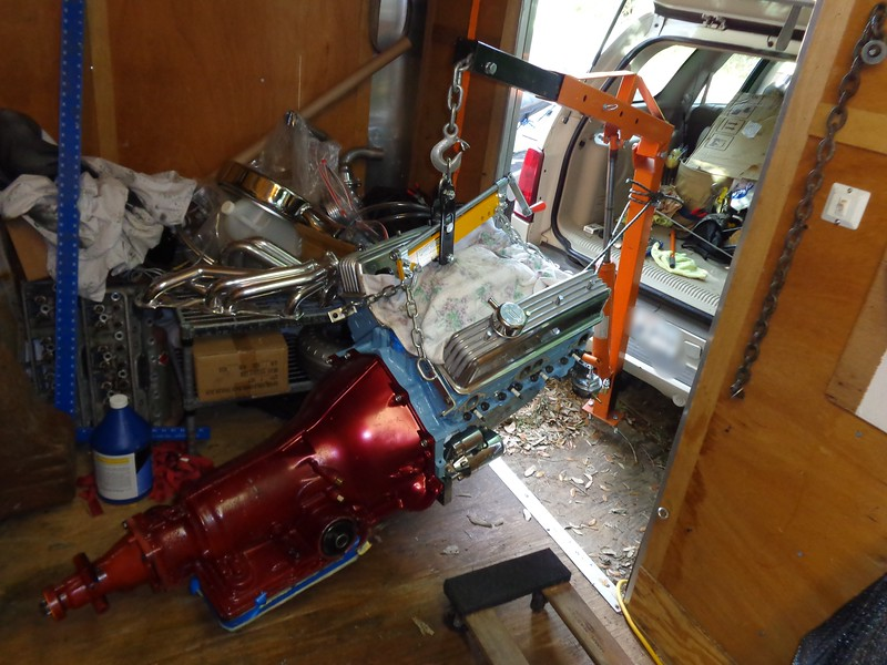 Got the transmission coupled up with the engine and testing the lift capabilities of my Caddie Crane. Taped up a paper/cloth transmission pan protection. Hate scratches. Was nearly surprised that the Caddie Crane could handle it. About 700 pounds.