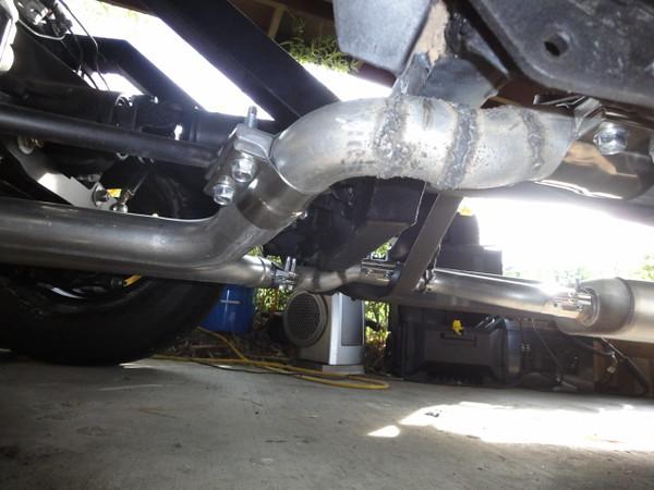 Underside of exhaust to offset under the intermediate crossmember.
